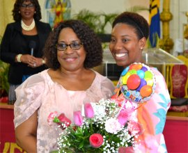 Dr. Angela Smith Prinicpal of Gorden Greenidge School 40 year celebration receiving gifts