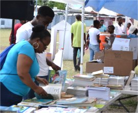 Impacting Our Communities Love Package book distribution